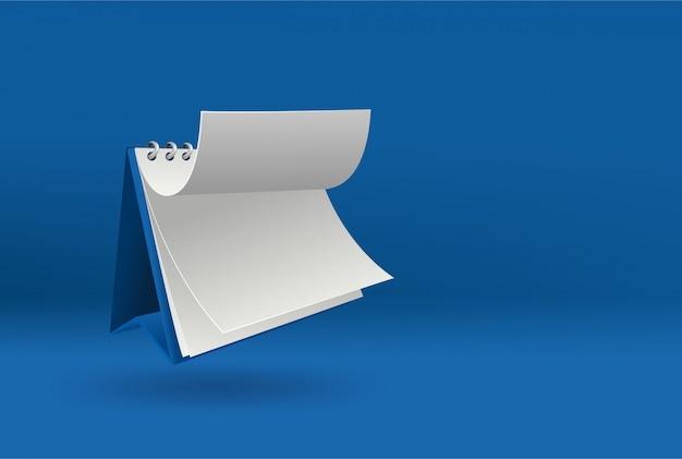 Modèle de calendrier vierge 3d avec couvercle ouvert sur bleu avec des ombres douces.