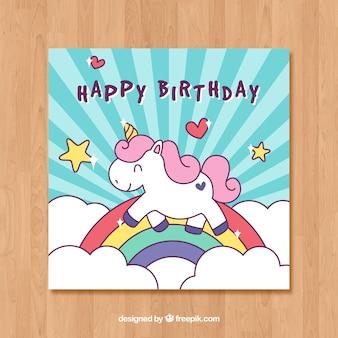 Modèle de carte d'anniversaire bleu avec une licorne