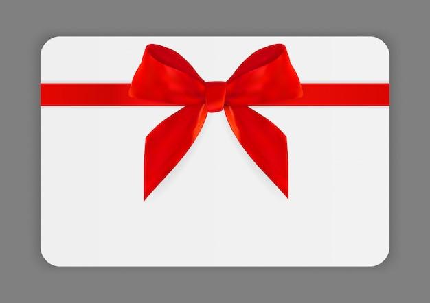 Modèle de carte-cadeau vierge avec un arc et un ruban rouge