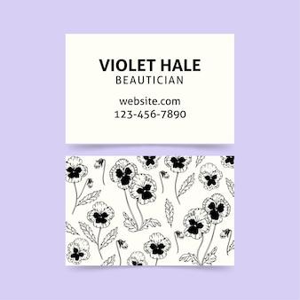 Modèle de carte d'entreprise dessiné main réaliste avec des fleurs