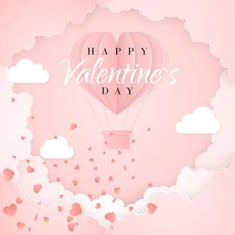 Modèle de carte d'invitation happy valentines day avec ballon à air chaud en papier origami en forme de coeur, nuages blancs et confettis. fond rose.