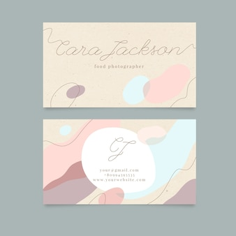 Modèle de carte de visite abstraite avec des taches de couleur pastel
