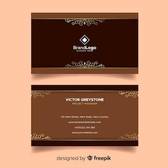 Modèle de carte de visite doré en style ornemental