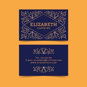 Modèle de carte de visite floral avec des lignes d'or