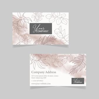 Modèle de carte de visite avec fond floral dessiné à la main