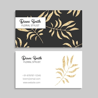 Modèle de carte de visite de luxe en or avec feuilles tropicales.