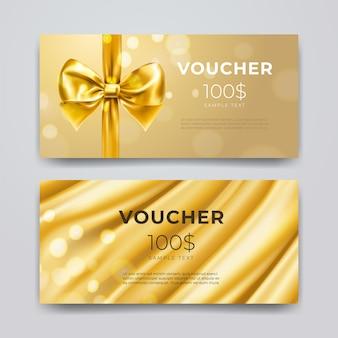 Modèle de conception de bon cadeau. ensemble de carte promotionnelle premium avec noeud doré réaliste, ruban et soie isolé sur fond de bokeh. certificats de réduction, coupon ou dépliant. illustration 3d.