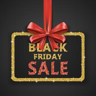Modèle de conception de vente vendredi noir avec ruban arc rouge et paillettes dorées