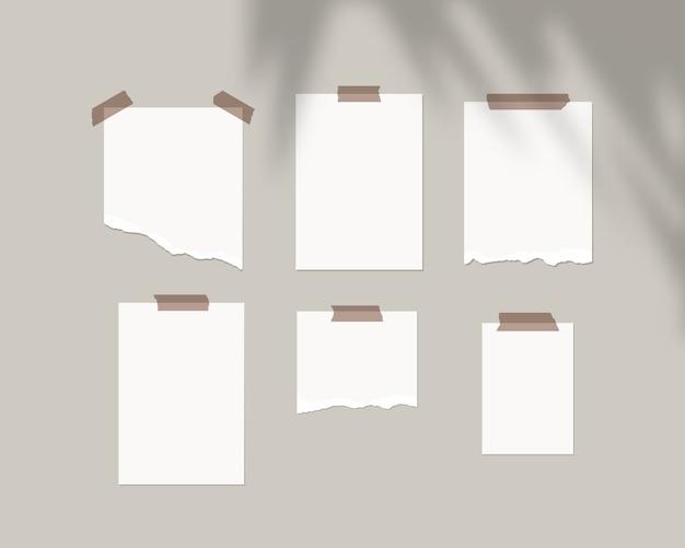Modèle de conseil d'humeur. feuilles vides de papier blanc sur le mur avec superposition d'ombre. isolé. conception de modèle. illustration réaliste.