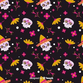Modèle de día de muertos plat avec têtes de mort et fleurs