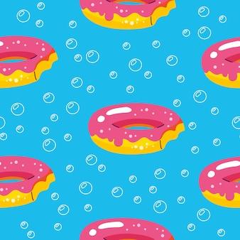 Modèle d'été avec des flotteurs de beignets et piscine