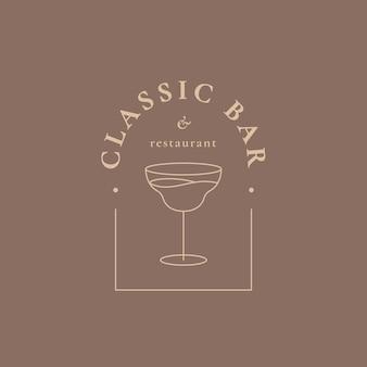 Modèle de logo de bar de luxe avec un verre à cocktail minimal