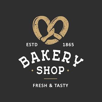 Modèle de logo d'emblème d'insigne d'étiquette de magasin de boulangerie de style vintage art alimentaire avec bretzel gravé