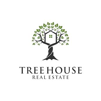Modèle de logo de maison dans les arbres