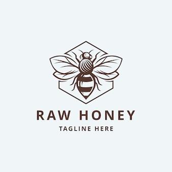 Modèle de logo de miel cru avec des feuilles