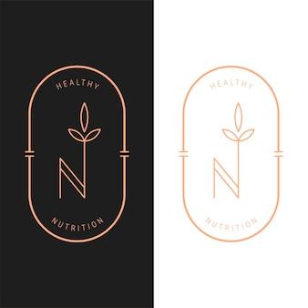 Modèle de logo ovale de nutrition vectorielle élégant en deux variations de couleur. création de logotype de style art déco pour l'image de marque d'une entreprise de luxe. conception d'identité haut de gamme. lettre n