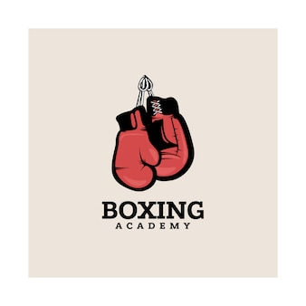 Modèle de logotype de boxe avec des gants de boxe suspendus.