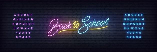 Modèle de néon de retour à l'école. concept de lettrage de retour à l'école rougeoyant