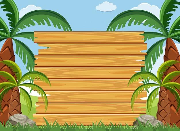 Modèle de panneau en bois avec des arbres verts dans le parc