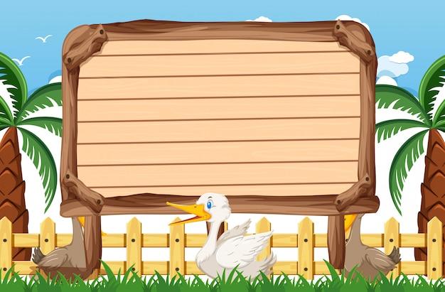Modèle de panneau en bois avec des canards dans le parc