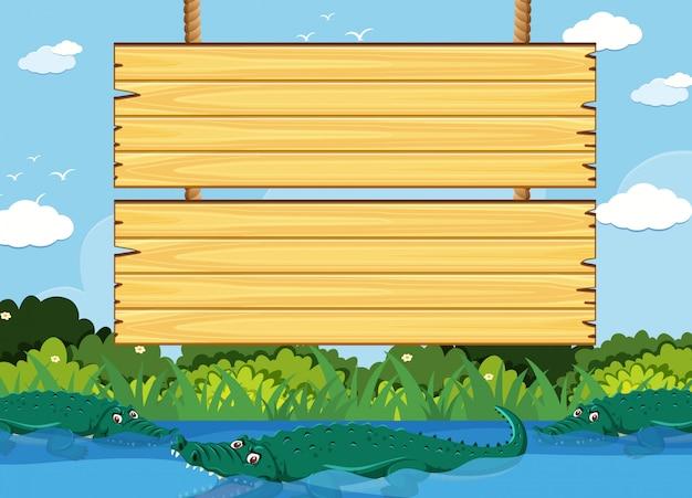 Modèle de panneau en bois avec crocodile dans le parc