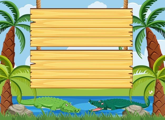 Modèle de panneau en bois avec crocodile nageant dans la rivière