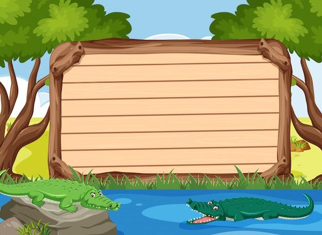 Modèle de panneau en bois avec des crocodiles dans le parc
