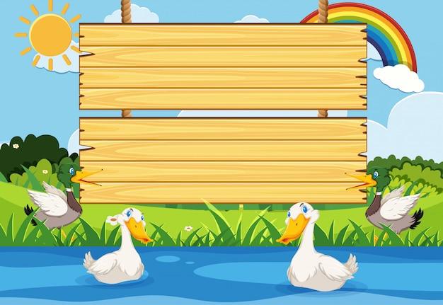 Modèle de panneau en bois avec de nombreux canards dans la rivière