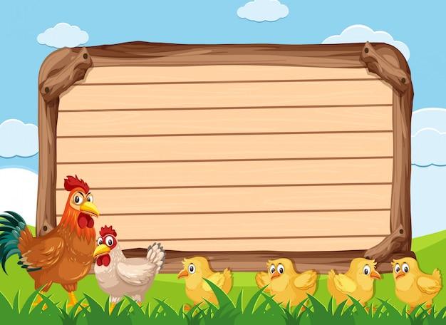 Modèle de panneau en bois avec de nombreux poulets dans les terres agricoles