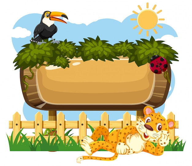 Modèle de panneau en bois avec toucan et tigre dans le parc