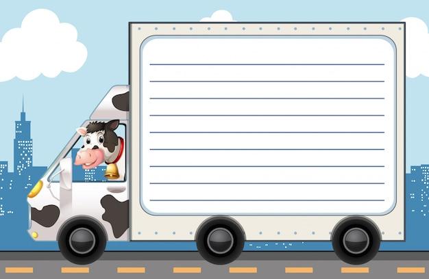 Modèle en papier de ligne avec vache dans le camion