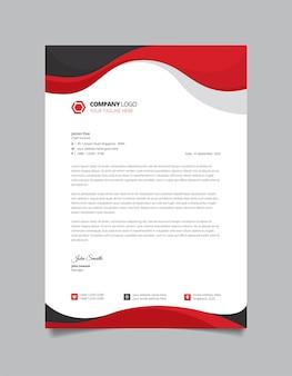 Modèle de papier à en-tête d'entreprise moderne avec des formes rouges et noires