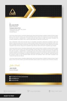 Modèle de papier à en-tête d'entreprise style moderne noir et or