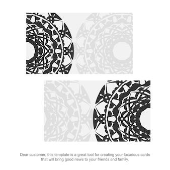 Modèle Pour La Conception D'impression De Cartes De Visite Couleurs Blanches Avec Des Motifs De Mandala Noirs. Préparation D'une Carte De Visite Avec Une Place Pour Votre Texte Et Ornements Grecs. Vecteur Premium