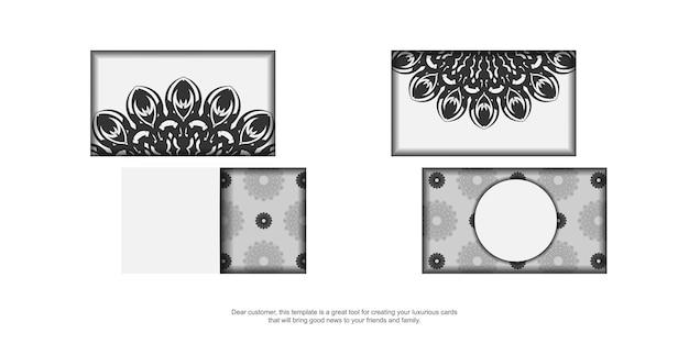 Modèle pour la conception d'impression de cartes de visite couleurs blanches avec ornement mandala. préparation de carte de visite vectorielle avec place sous votre texte et motifs noirs.