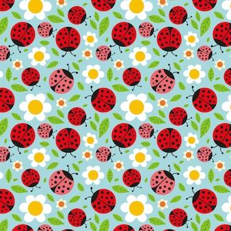 Modèle pour le printemps avec des coccinelles et des fleurs
