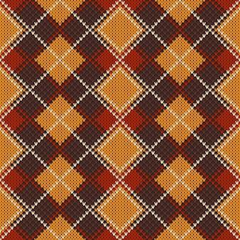 Modèle de pull tricoté abstrait argyle.