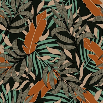 Modèle sans couture abstrait original avec des feuilles tropicales colorées et des plantes sur un fond sombre
