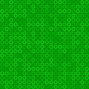 Modèle sans couture abstrait de petits anneaux ou pixels dans des couleurs vertes
