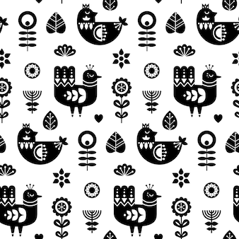 Modèle sans couture d'art populaire avec des oiseaux et des éléments floraux décoratifs