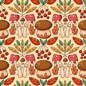 Modèle sans couture d'automne avec des baies de champignons et des feuilles branche de sorbier caricature dessinée à la main