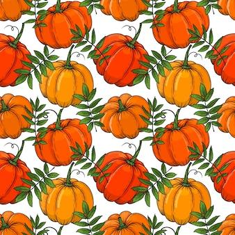 Modèle sans couture automne dessiné main de citrouilles de couleur et de feuilles. illustration. coloré.