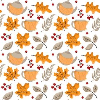 Modèle sans couture d'automne orange feuilles et baies, théière avec tasses tricotées.