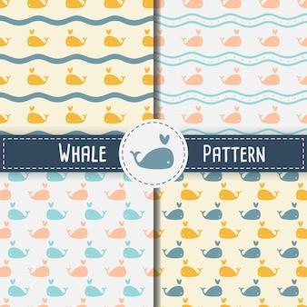 Modèle sans couture de baleines sur fond bleu
