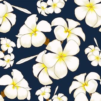 Modèle sans couture blanc fleurs de frangipanier abstrait bleu foncé.