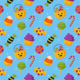 Modèle sans couture de bonbons halloween sur fond bleu.
