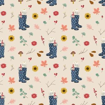 Modèle sans couture avec des bottes wellie, des feuilles d'automne et des fleurs.