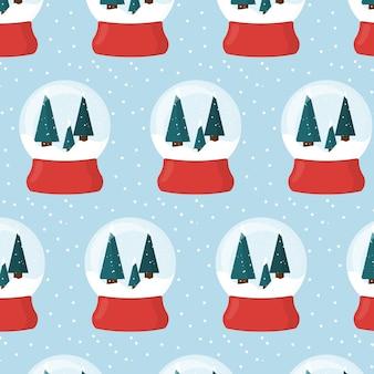 Modèle sans couture avec boule à neige de noël sur support rouge boule à neige boule à neige avec arbres de noël