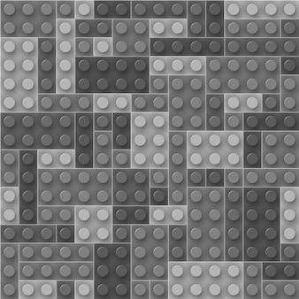 Modèle sans couture de briques en plastique gris réalistes. blocs de construction. laissez tomber les échantillons et profitez-en.
