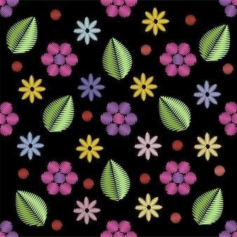 Modèle sans couture de broderie avec des fleurs.